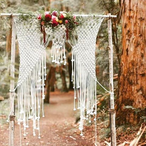 birch branch wedding arch with macrame and bold florals