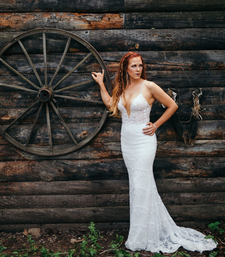 The bride chose a dress by Berta Bridals with spaghetti straps and a plunging neckline