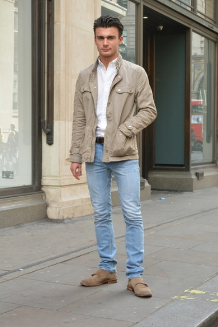 With white shirt, beige jacket and jeans