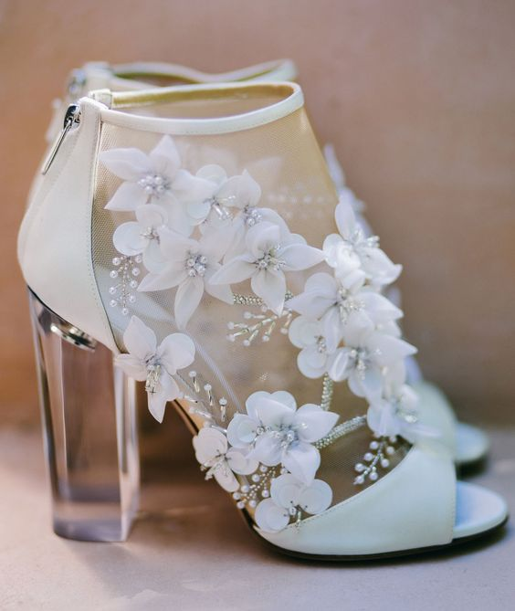 peep toe boots with lucite heels, zips and fabric flower appliques look very modern and girlish