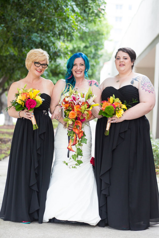 The bridesmaids were wearing strapless black gowns