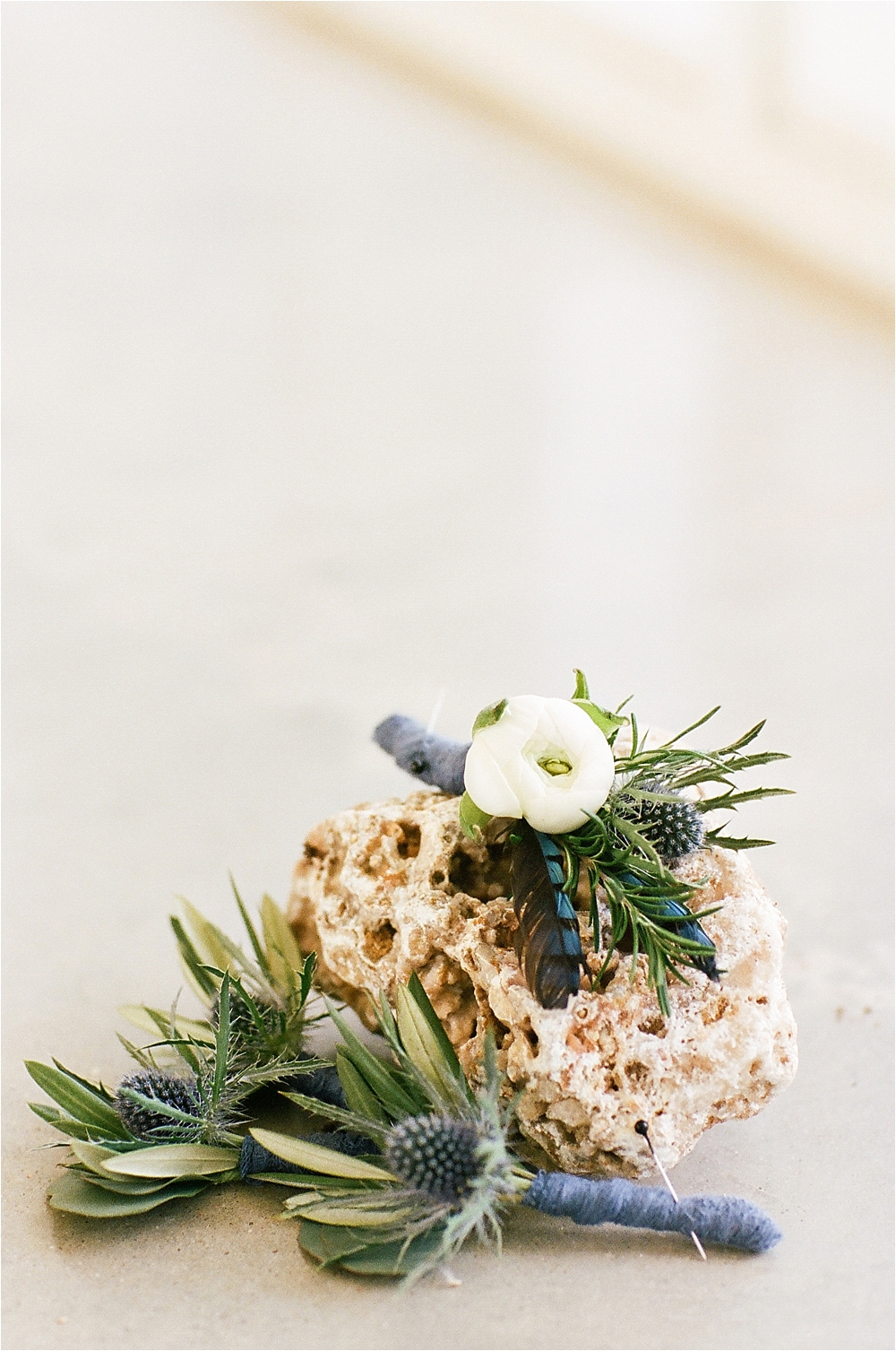 wedding boutonnieres - photo by Flora and Fauna http://ruffledblog.com/modern-bohemian-wedding-with-an-air-plant-bouquet