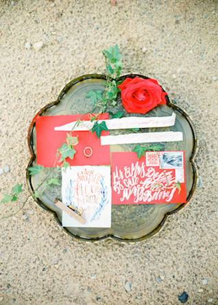 Red envelope with white calligraphy | Kir & Ira Photography