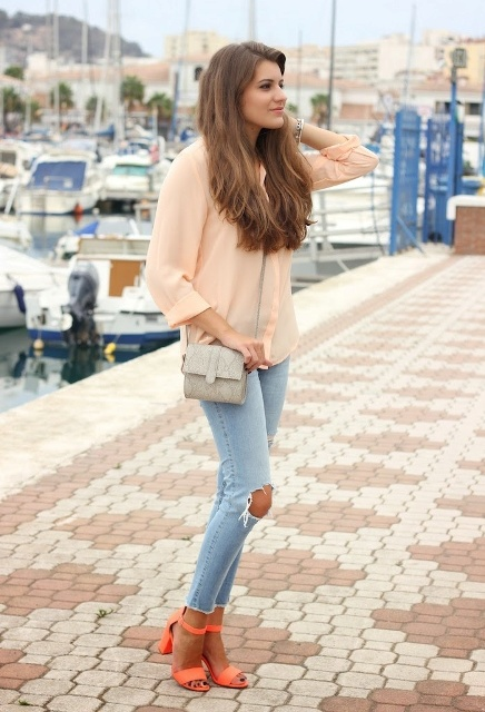 With peach blouse, jeans and mini bag