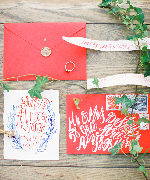 White calligraphy on red envelope | Kir & Ira Photography