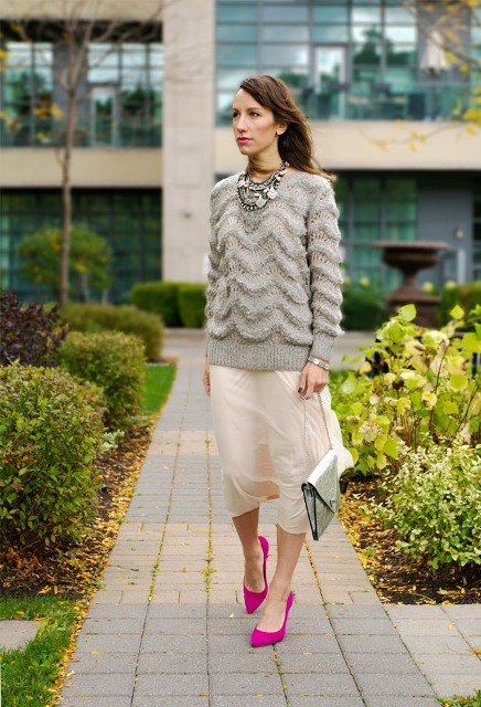 With oversized sweater, midi skirt and metallic bag