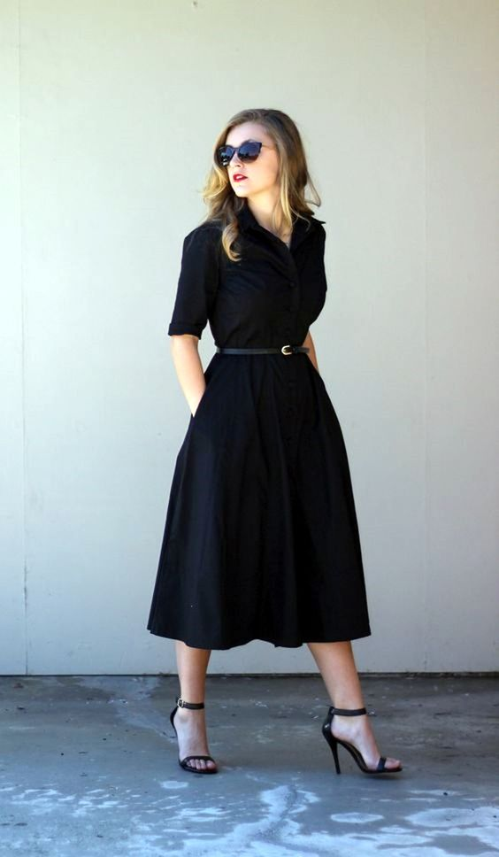 a black midi dress, a leather belt and black ankle strap heels