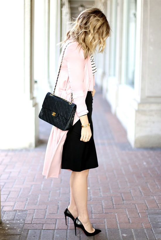 a light pink trench coat, a black and white striped top, a black pencil skirt, black heels