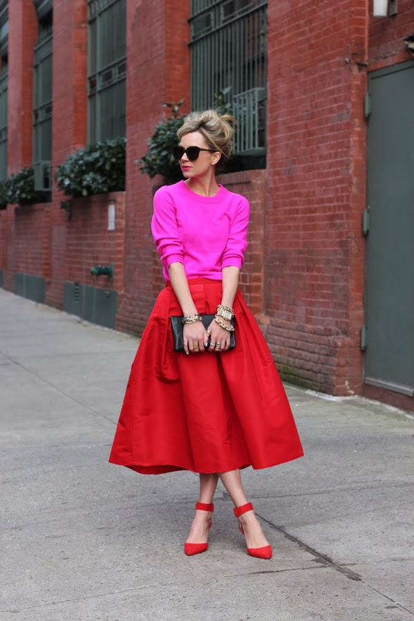 a red midi, a pink top and red poainted shoes