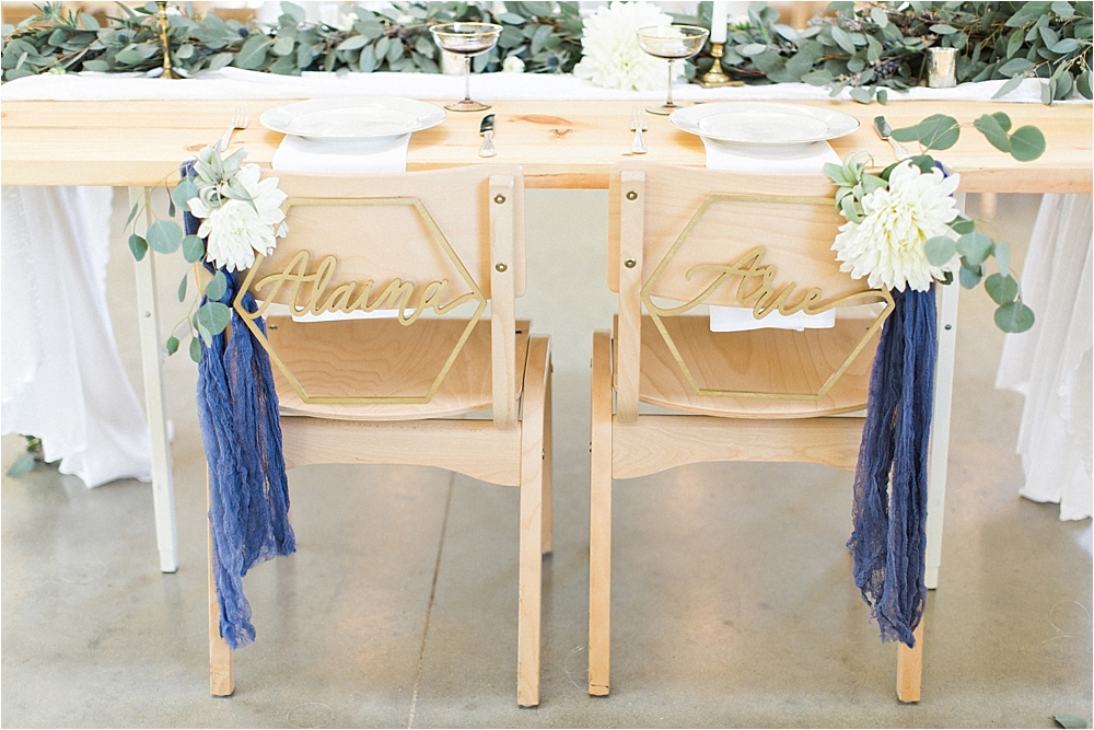 sweetheart table chairs - photo by Flora and Fauna http://ruffledblog.com/modern-bohemian-wedding-with-an-air-plant-bouquet