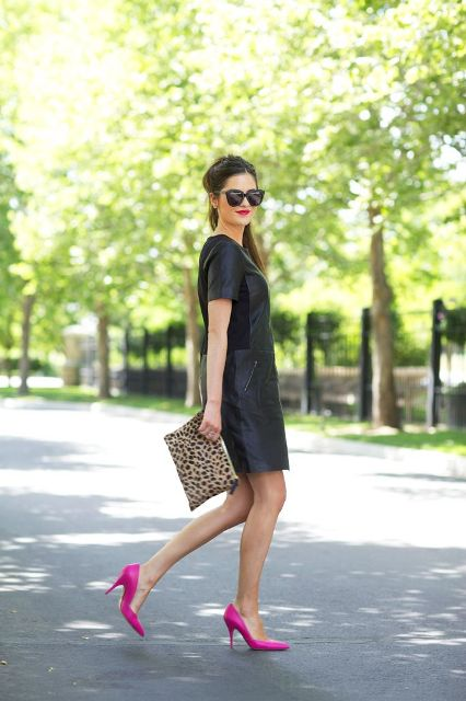 With black leather dress and leopard clutch