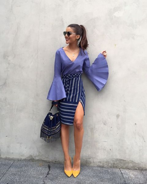 With purple bell sleeve blouse, striped skirt and bag