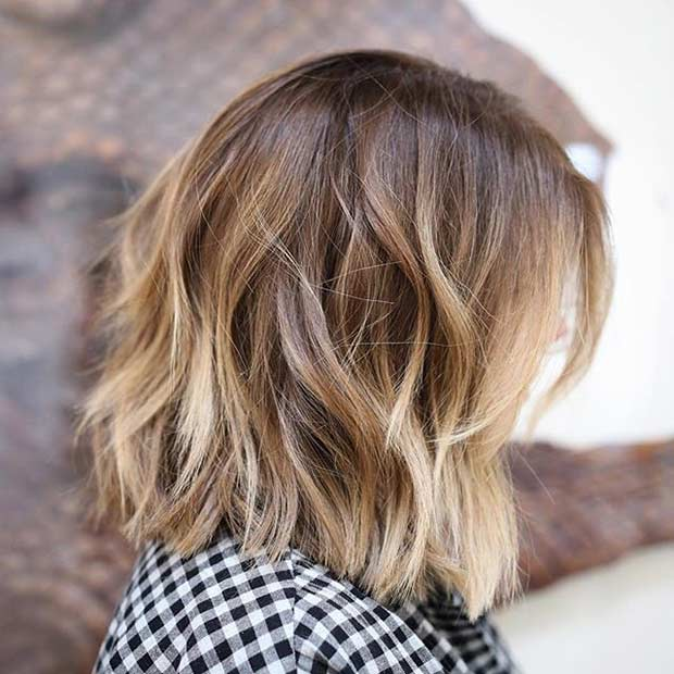 Layered Bob Haircut with Blonde Highlights