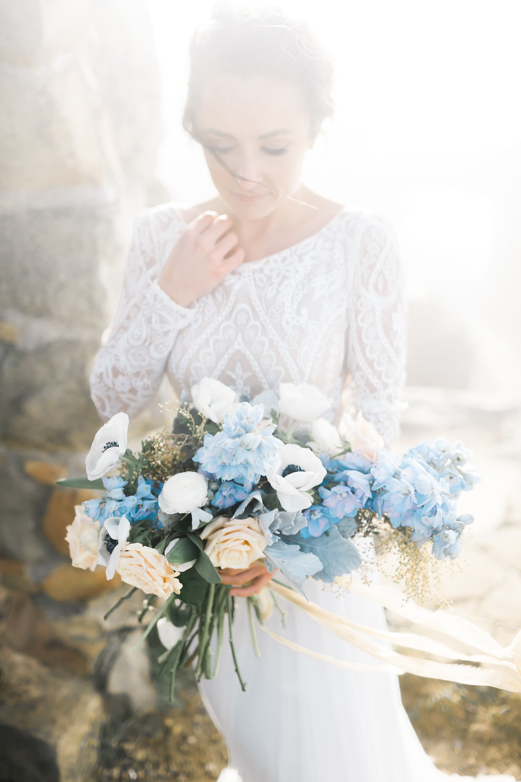 blue and white bouquets - photo by Natalie Schutt http://ruffledblog.com/misty-dream-vow-renewal-at-knapps-castle