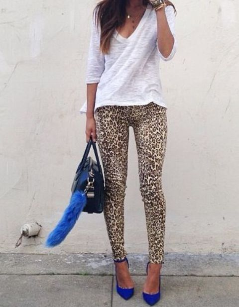 With white shirt, leopard leggings and black bag
