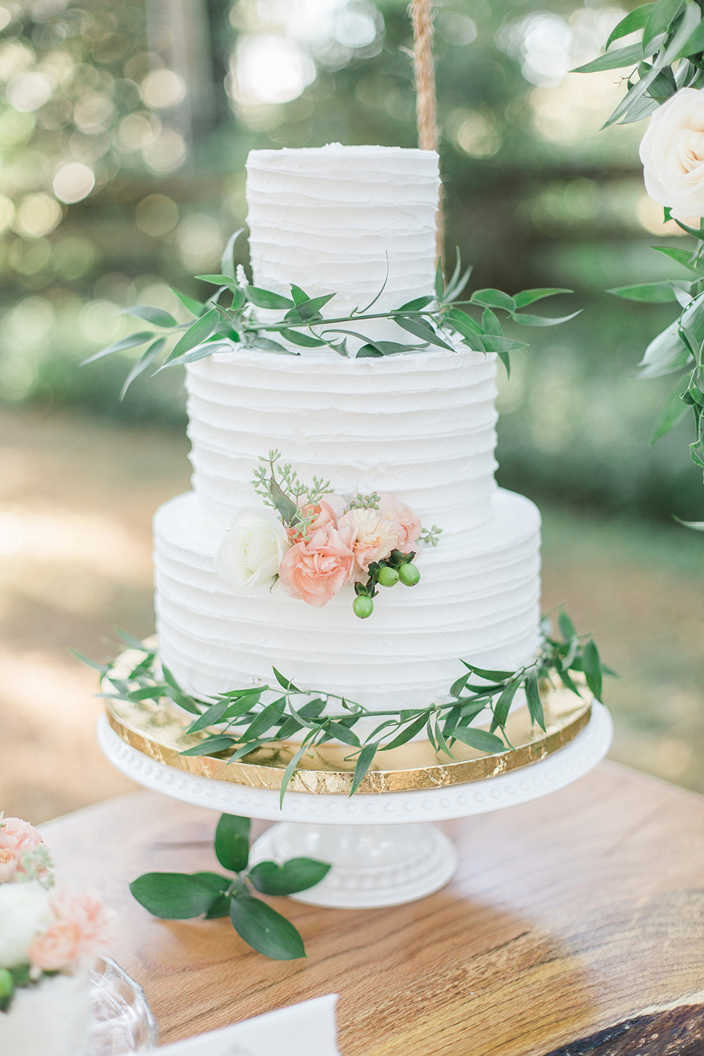 romantic wedding cake - photo by Landon Hendrick Photography http://ruffledblog.com/southern-garden-chic-wedding-inspiration