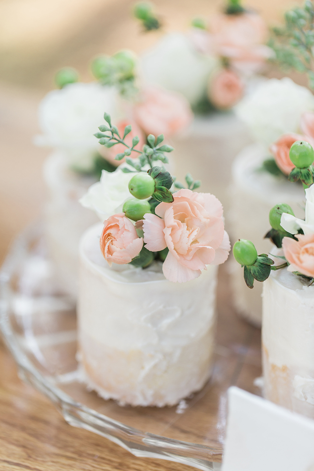 mini cakes - photo by Landon Hendrick Photography http://ruffledblog.com/southern-garden-chic-wedding-inspiration
