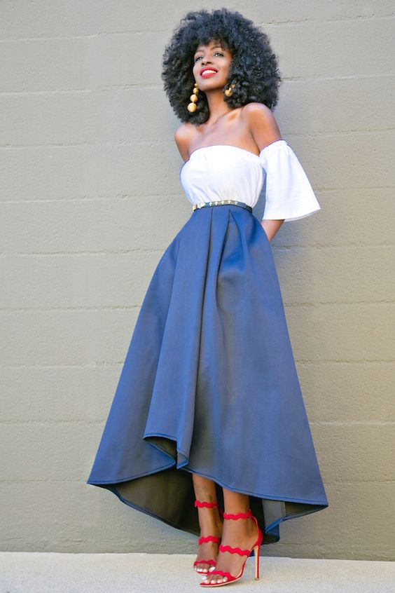 off the shoulder white top, a navy high low midi skirt and red strap sandals