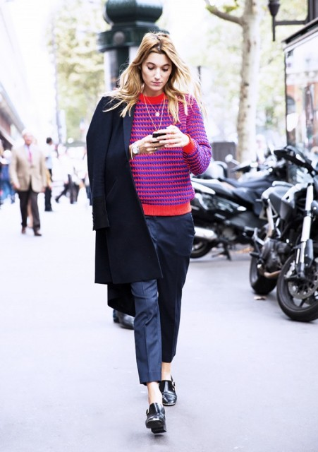 With striped sweater, navy blue trousers and coat