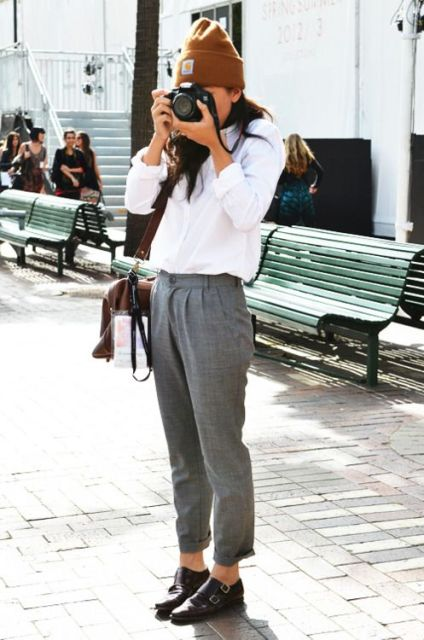 With white shirt, gray trousers and beanie