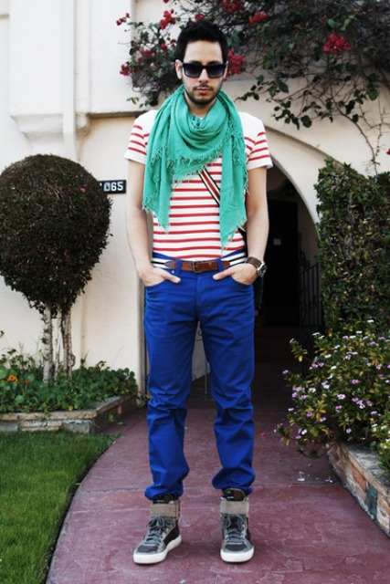With red striped shirt, green scarf and sporty boots