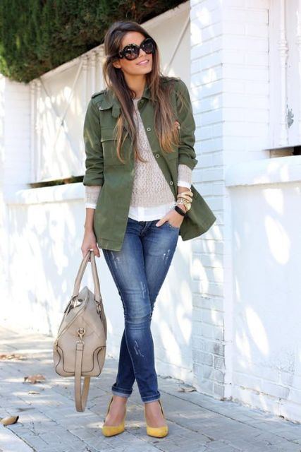 With beige shirt, green army jacket and skinny jeans