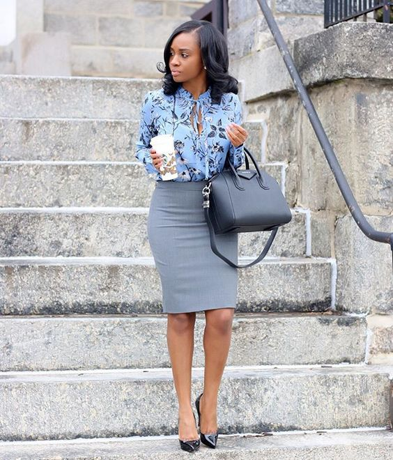 a grey knee skirt, a blue floral blouse and black shoes