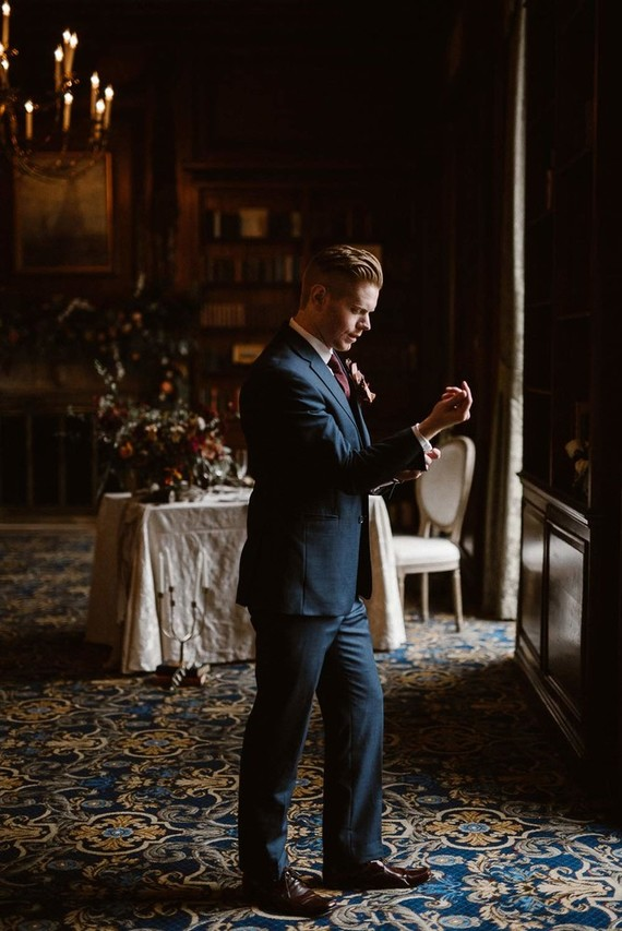 The groom was rocking navy suit with a burgundy tie and shoes