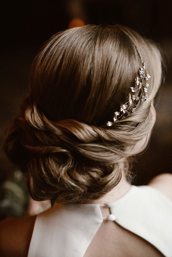 The bride was rocking a twisted updo with a rhinestone headpiece