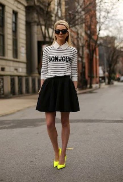 With striped shirt and black skater skirt