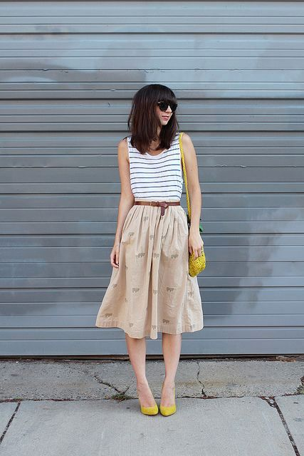 With striped top, A-line skirt and yellow bag