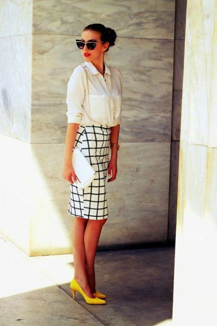 With white button down shirt, checked skirt and white clutch
