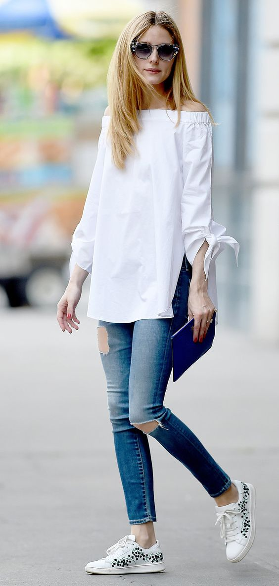ripped jeans, a white off the shoulder and white sneakers