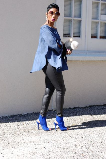 With denim loose shirt, leather leggings and metallic clutch