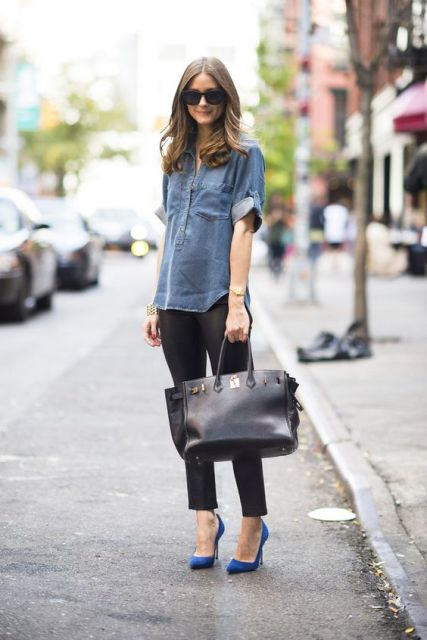 With denim shirt, black trousers and big bag
