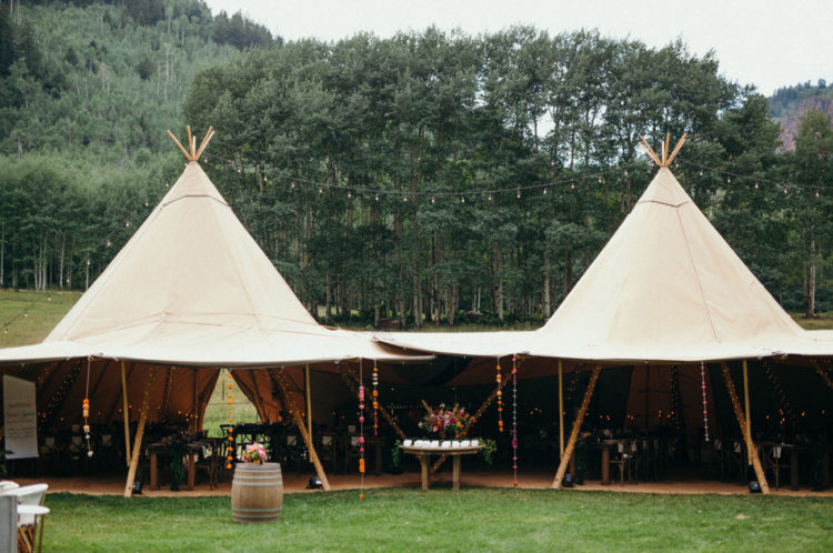 The reception and dinner took place under teepees as it's a boho wedding