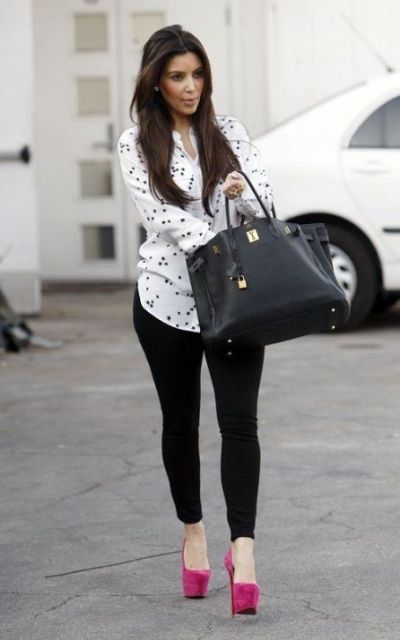 With polka dot shirt, skinny pants and black bag
