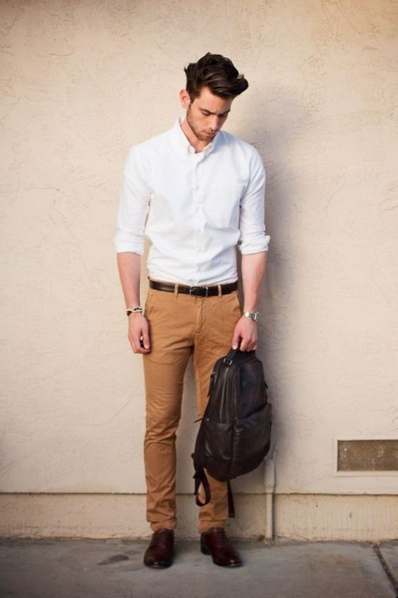 ocher jeans, a white shirt, brown leather shoes