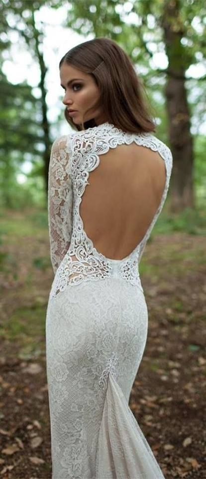 lace mermaid wedding dress with sleeves and a circle cutout back