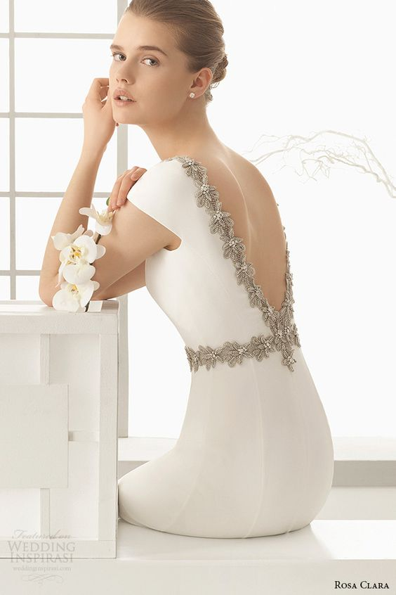 plain white wedding dress with cap sleeves and a heavily beaded V cut back