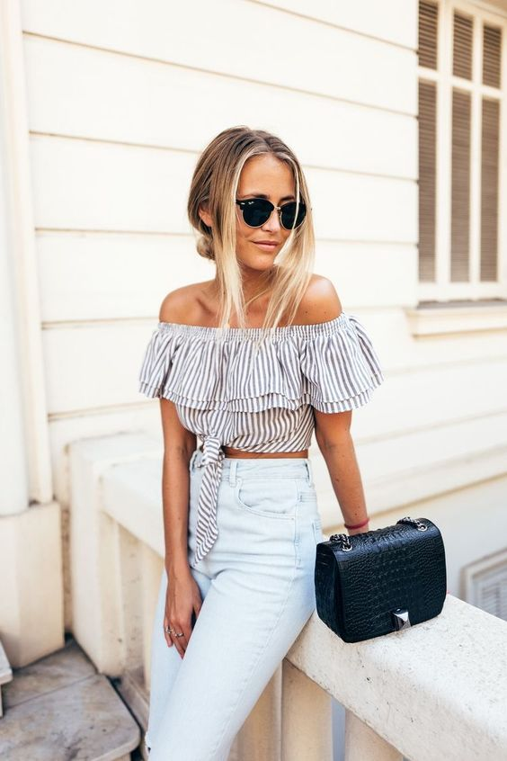 striped off the shoulder top with high waisted jeans is a classy and retro inspired spring outfit idea