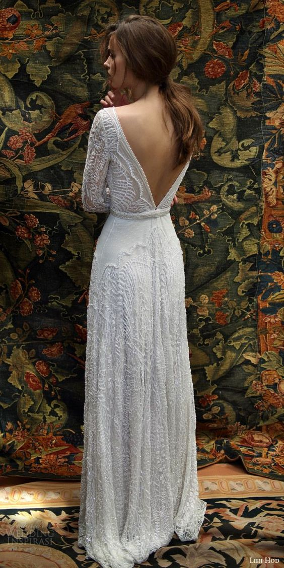 heavily beaded lace wedding dress with long sleeves and a V cut back