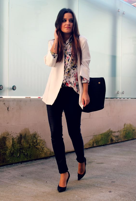 black pants and heels, a floral shirt and a white blazer