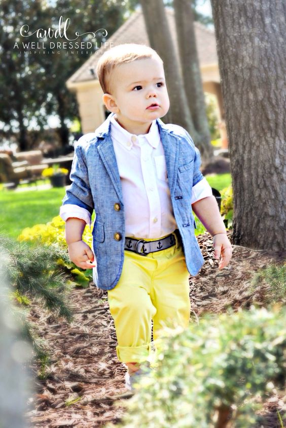 a blue jacket, a white shirt and yellow pants
