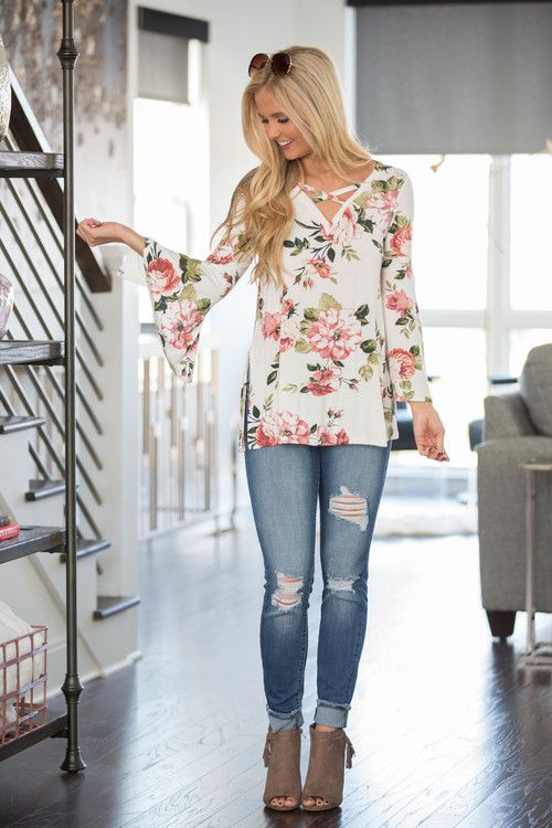 ripped skinnies, a tender floral blouse and suede boots
