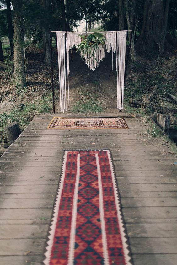 wedding arch with macrame hanging and greenery