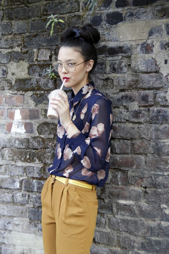 a printed sheer floral blouse, those mustard pants highlighted with that sunkissed yellow belt