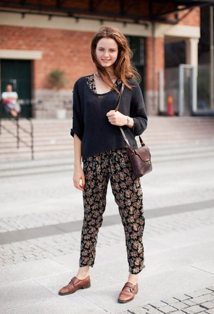With floral jumpsuit, black shirt and brown bag