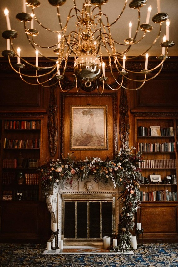 The fireplace was decorated with a lush floral garland and candles