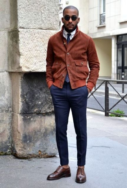 With white shirt, polka dot tie, navy blue pants and brown shoes